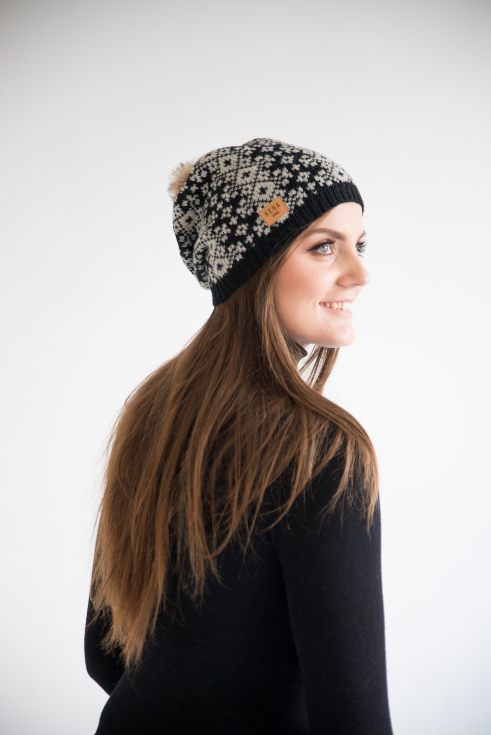 Knitted merino wool beanie with fur pom pom