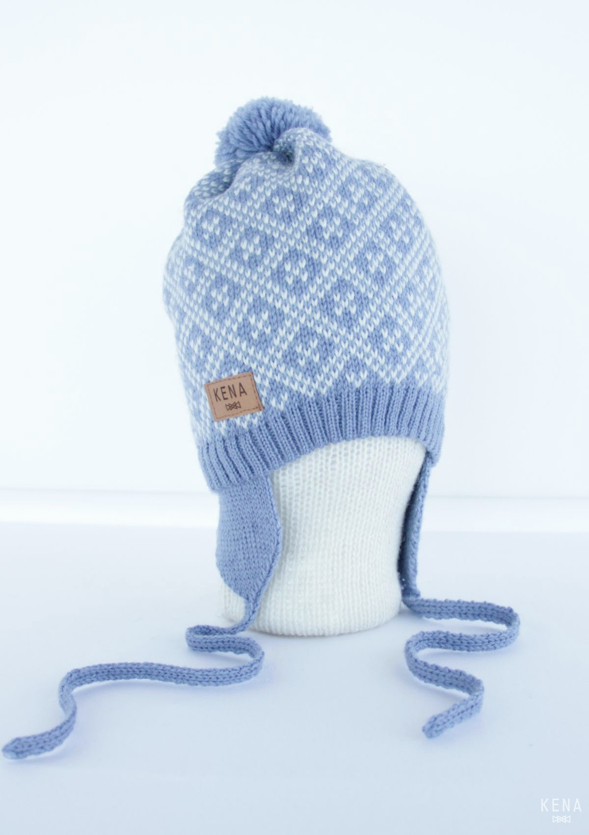 83a509143 Knitted pure merino wool pom pom earflap hat
